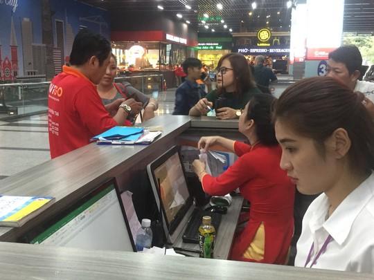 Sân bay Tân Sơn Nhất có dịch vụ xe ôm AVIGO Bike - Ảnh 1.