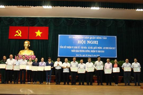 TP HCM: Quận Bình Tân phấn đấu không còn hộ nghèo - Ảnh 1.