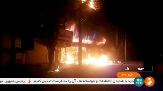 Iran: Cố trộm súng cảnh sát, 6 người biểu tình thiệt mạng - Ảnh 4.