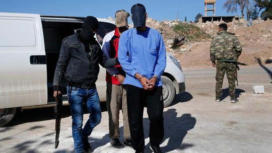 Nan giải số phận tù binh IS ở Syria - Ảnh 1.