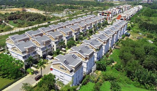 Lợi nhuận doanh nghiệp bất động sản tăng 65% - Ảnh 1.