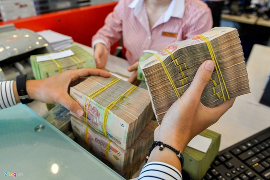 Nhận thưởng Tết gửi tiền vào ngân hàng nào lãi suất tốt nhất? - Ảnh 1.