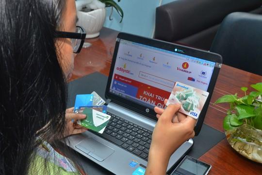 Chuyển đổi hàng chục triệu thẻ ATM sang thẻ chip - Ảnh 1.