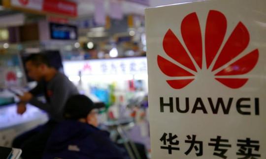 Trước thềm đàm phán với Trung Quốc, Mỹ giáng đòn sốc lên Huawei - Ảnh 1.