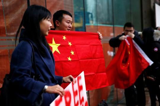 Trung Quốc bắt giam 13 công dân Canada sau vụ Huawei - Ảnh 1.