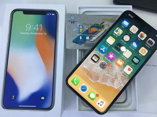 iPhone lock Mỹ bất ngờ được lên đời quốc tế miễn phí tại Việt Nam - Ảnh 1.