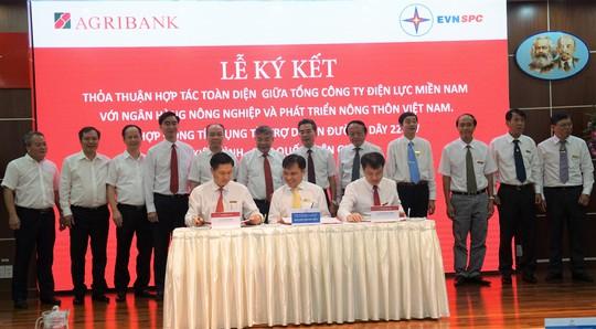 EVNSPC ký kết thỏa thuận hợp tác với Agribank - Ảnh 1.