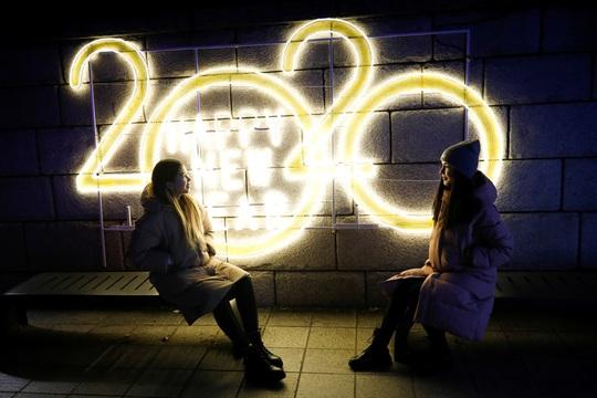 Châu Á đón năm mới đầy tâm trạng - Ảnh 2.