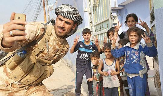 Nga hồi hương từ Iraq 27 con phiến quân IS - Ảnh 1.