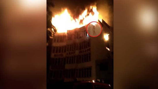 Cháy khách sạn, 21 người thương vong - Ảnh 1.