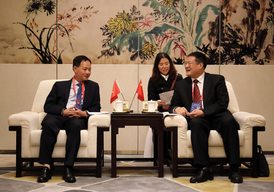 Việt Nam và Trung Quốc đẩy mạnh hợp tác dự báo bão, thiên tai - Ảnh 3.