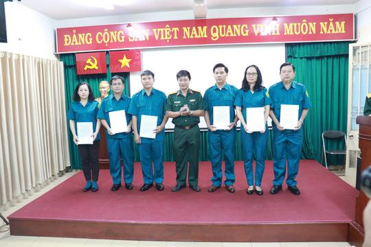 Thành lập Ban chỉ huy quân sự và lực lượng Trung đội dân quân tự vệ Công ty Cổ phần Cấp nước Bến Thành - Ảnh 1.
