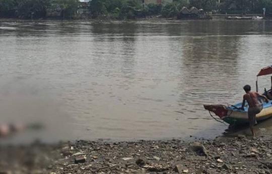 Tìm thấy thi thể cô gái bị thả xuống sông Thu Bồn - Ảnh 1.