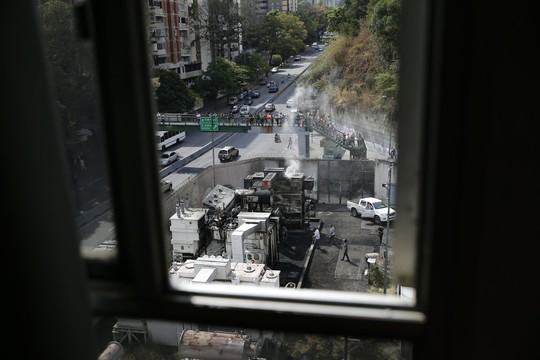 """Venezuela: Hỗn loạn gia tăng, bắt 2 nghi phạm """"phá hoại lưới điện"""" - Ảnh 1."""