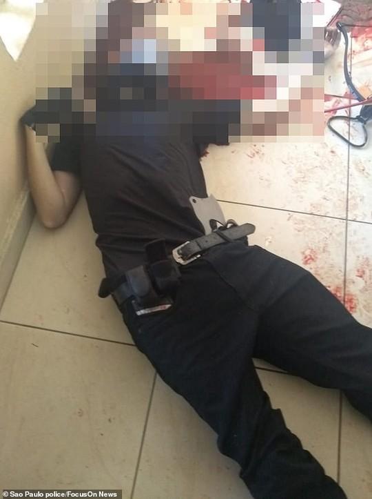 Brazil: Cựu học sinh vào trường xả súng, 27 người thương vong - Ảnh 5.