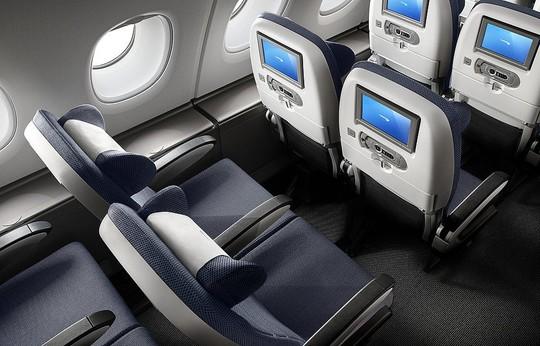 Sự khác biệt khi ngồi khoang hạng nhất và phổ thông trên máy bay - Ảnh 9.