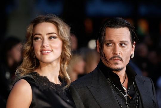 """""""Cướp biển"""" Johnny Depp bị vợ cũ tố là """"quái vật"""" bạo hành - Ảnh 2."""