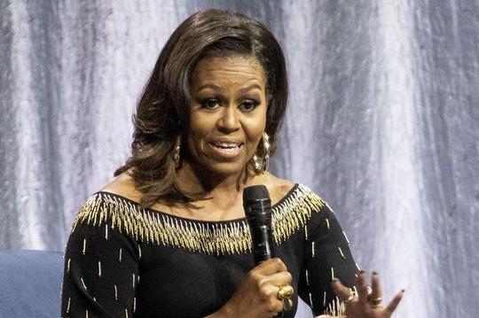 Bà Obama so sánh Tổng thống Trump với ông bố đã ly dị - Ảnh 1.