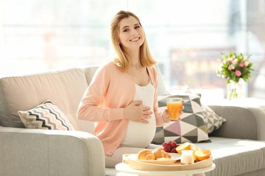 Dinh dưỡng đúng thai kỳ để mẹ khỏe con khôn - Ảnh 2.