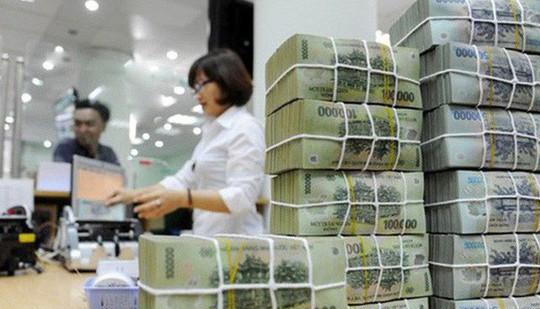 """Hơn 100.000 tỉ đồng ngân sách """"cố thủ"""" tại Vietcombank, BIDV - Ảnh 1."""
