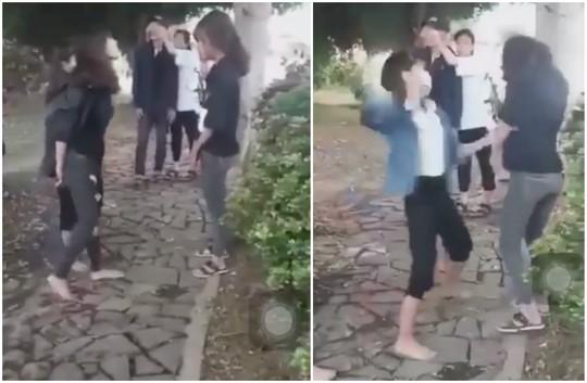Xôn xao clip 2 nữ sinh đến trường uy hiếp, xử bạn vì… thích là đánh! - Ảnh 1.