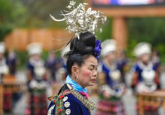 Làng cổ 1.700 tuổi của dân tộc Miêu ở Trung Quốc - Ảnh 6.