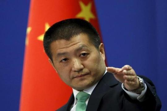 Trung Quốc tố Mỹ dối trá về cuộc chiến thương mại - Ảnh 1.