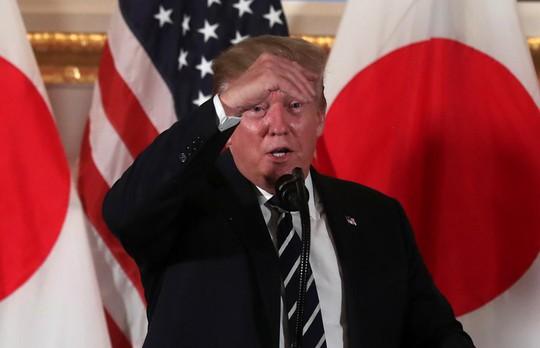 Ông Donald Trump vẫn tin tưởng ông Kim Jong-un, bất chấp 2 vụ phóng tên lửa - Ảnh 1.