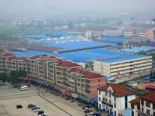 Ngắm ngôi làng giàu có nhất Trung Quốc - Ảnh 2.