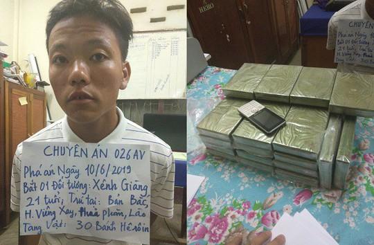 Bat qua tang doi tuong om 30 banh heroin