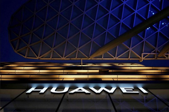 Công ty Mỹ ép chính phủ giảm lệnh cấm Huawei - Ảnh 1.