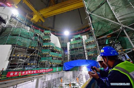 Trung Quốc có thể xây dựng 30 lò phản ứng hạt nhân ở nước ngoài - Ảnh 1.