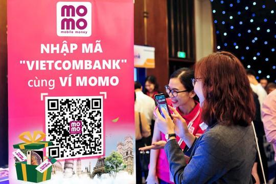 Kích thích thanh toán không dùng tiền mặt, MoMo và Vietcombank tung khuyến mãi khủng - Ảnh 2.