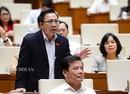 Bộ trưởng Công an Tô Lâm trả lời chất vấn của đại biểu Lưu Bình Nhưỡng - Ảnh 1.