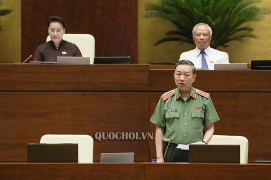 Bộ trưởng Công an Tô Lâm trả lời chất vấn của đại biểu Lưu Bình Nhưỡng - Ảnh 2.