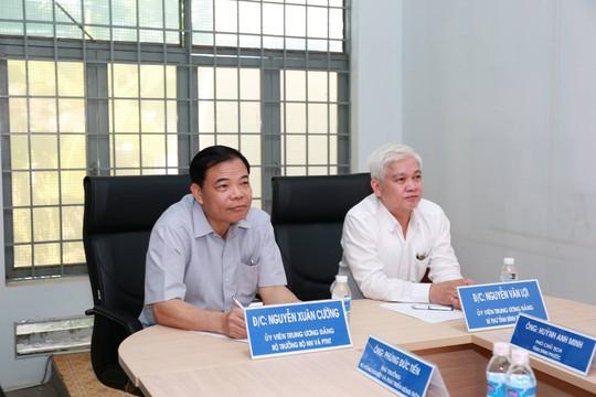 Bộ trưởng Nguyễn Xuân Cường đến thăm chuỗi sản xuất thịt gà xuất khẩu của C.P. Việt Nam tại Bình Phước - Ảnh 1.