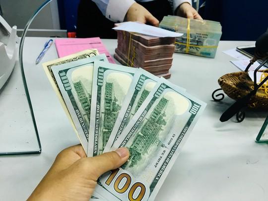 Thương chiến Mỹ - Trung căng thẳng, tiền đồng Việt Nam vẫn ổn định - Ảnh 1.
