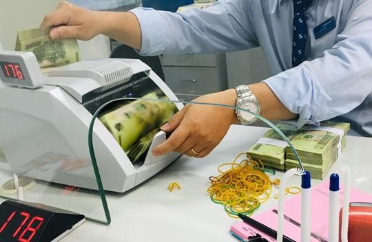 Nới room tín dụng sẽ có thêm bao nhiêu tiền đổ vào nền kinh tế? - Ảnh 1.