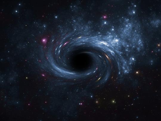 Hàng triệu lỗ đen lạ đang gặm nhấm thiên hà chứa trái đất - Ảnh 1.