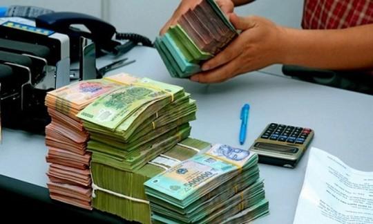 Thưởng Tết, lương tháng 13 và cách tính thuế thu nhập cá nhân - Ảnh 1.