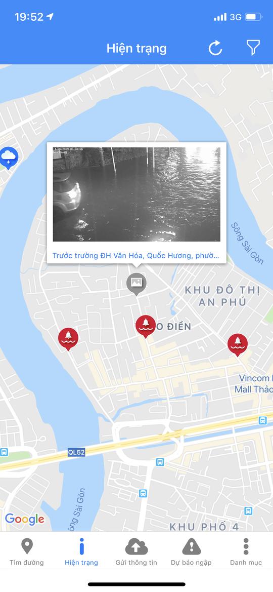 Mưa trắng trời, đường Nguyễn Hữu Cảnh lại ngập - Ảnh 7.