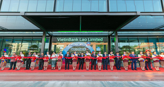 Ngân hàng Việt mở rộng mạng lưới ra nước ngoài - Ảnh 1.