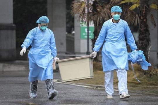 Trung Quốc có ca tử vong đầu tiên vì dịch viêm phổi lạ - Ảnh 1.