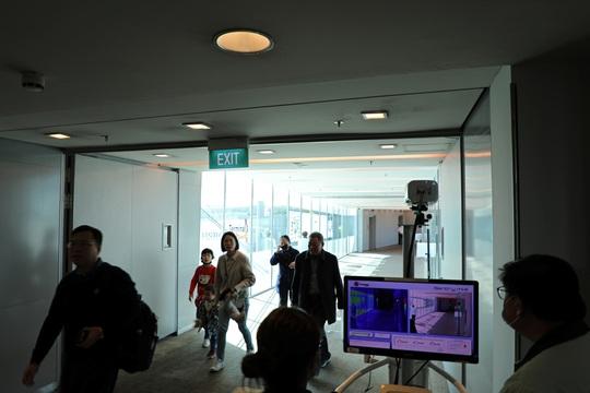 Lo virus corona mới, Singapore đóng cửa với du khách từ Trung Quốc - Ảnh 1.