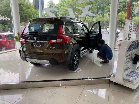 Nhiều người dùng phản ánh ôtô Suzuki XL7, Ertiga bị thấm dầu, hụt hơi - Ảnh 1.