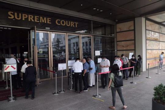 Thủ tướng Singapore đến tòa án kiện blogger chia sẻ thông tin sai sự thật - Ảnh 2.