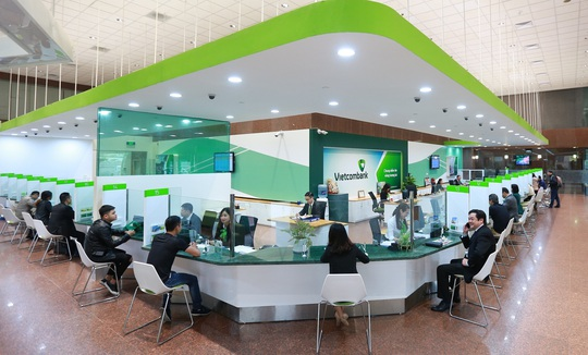 Vietcombank giảm lãi suất cho khách bị ảnh hưởng bão lũ - Ảnh 1.