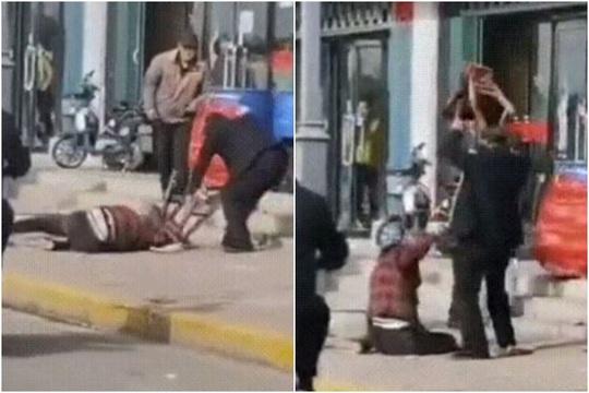 Trung Quốc: Người đi đường đứng xem nạn nhân chết trong vụ bạo lực gia đình - Ảnh 1.