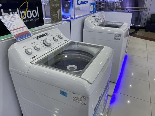 Máy giặt trục đứng nhập khẩu có gì lạ? - Ảnh 1.
