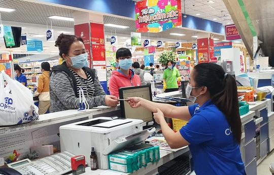 Mua hàng giá giảm còn 1.000 đồng tại siêu thị Co.opmart và Co.opXtra - Ảnh 1.